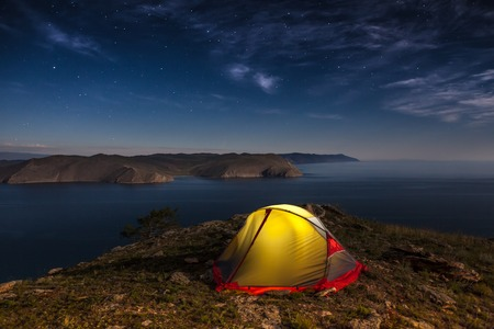 iluminated: Iluminated tent against mountain at moon night Stock Photo