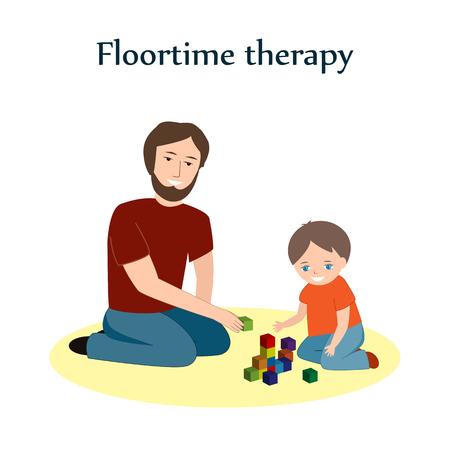 Mały chłopiec i jego ojciec siedzi na podłodze i gra z klocków. Technika terapii Floortime, stosowana do nauczania dzieci, szczególnie dla dzieci z ASD lub autyzmem