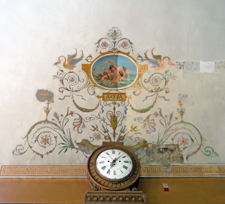 old pattern on the wall and clock photo