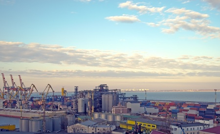import and export business: Cranes and containers at a port in the late afternoon period