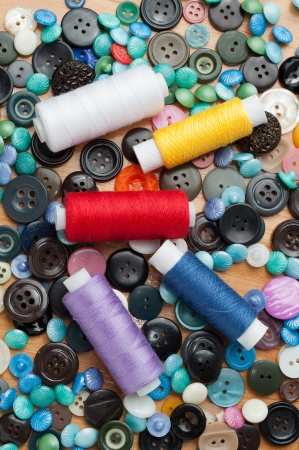 fash: buttons and spools of thread