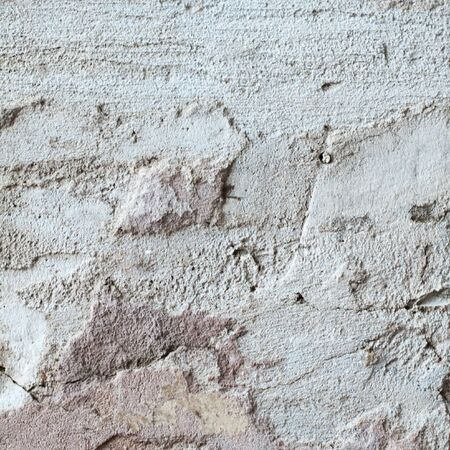 texture of plaster with a large crack photo