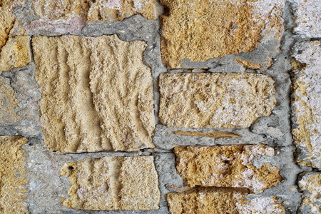 indent: wall of limestone blocks in plaster and pits