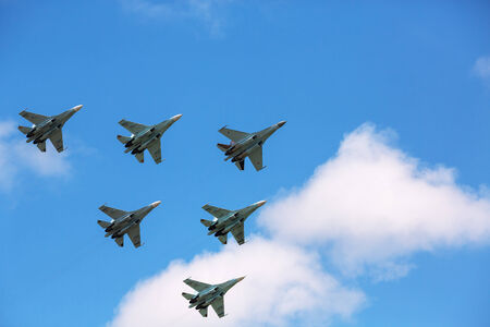 A group of Russian Su-27 performing group aerobatics at an airshow