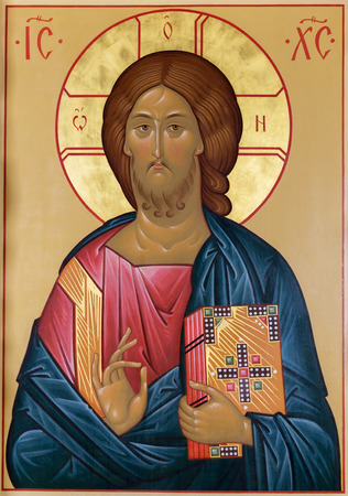 Image of Christ with the gospel and the hand of blessing on the ancient Russian icon Foto de archivo
