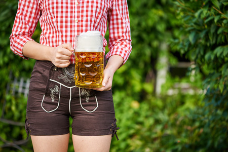 leather pants: Woman with leather pants and beer mug Stock Photo