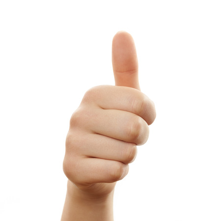 Hand with a thumbs up sign isolated on white background