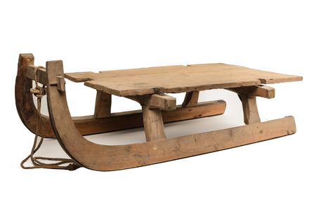 old wooden sledge isolated on white background