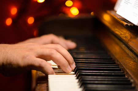 Playing piano, hands detail