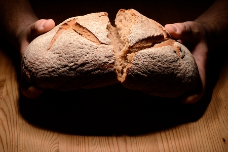 Breaking bread Stock Photo