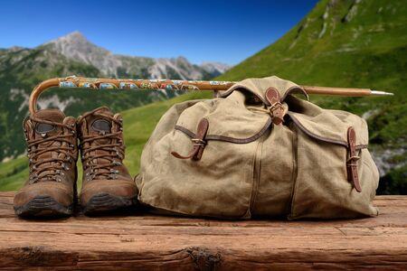 discoverer: Hiking equipment with hills in the background