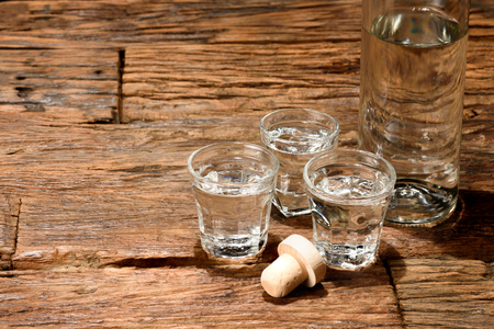 shot: Shot glasses on an old wooden table. Stock Photo