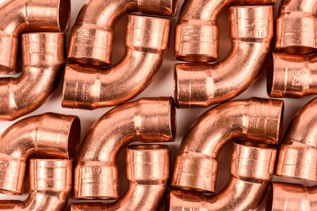 copper pipe: Copper elbow, copper pipe, industrial background