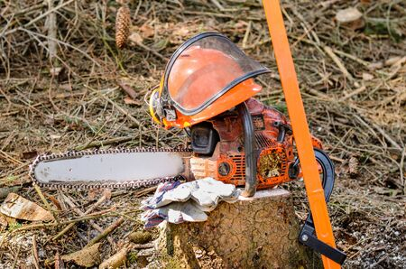 Equipment for woodcutter chain saw and helmet