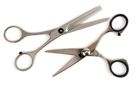haircutting: Professional haircutting scissors isolated on white background Stock Photo