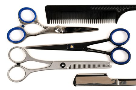 Professional haircutting scissors and comb isolated on white background Stock Photo