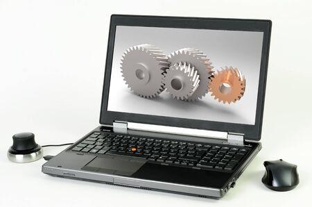 CAD 시스템이 장착 된 노트북과 화면의 톱니 바퀴