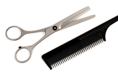 haircutting: Professional haircutting scissors and comb isolated on white background Stock Photo