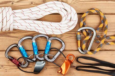 descender: Climbing equipment on wooden background