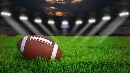 American football arena with ball on green grass illumination at night, 3D rendering Stock Photo
