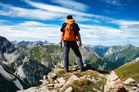 Hiker enjoying the view from the top of a mountain
