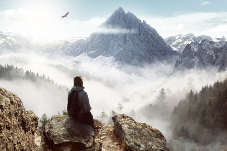 Woman enjoying the view from the top of a mountain
