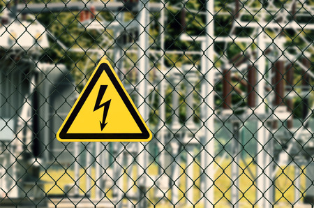 Electrical hazard sign placed on a fence of an electrical substation 版權商用圖片