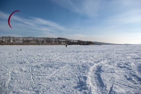 frozen river: Winter kite skiing on the frozen river