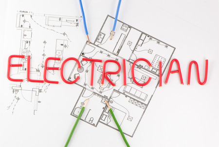 wiring: Word master electrician on the background of the wiring scheme Stock Photo