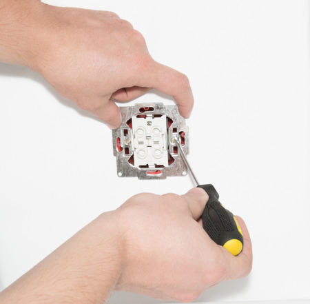 Installation of an electric switch with a screwdriver