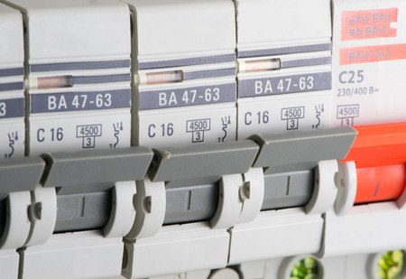 breakers: Circuit breakers are gray and red color close-up