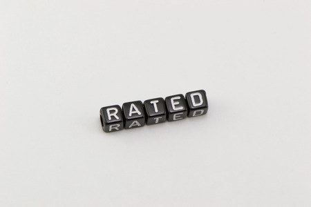 rated: Rated word on a white background Stock Photo