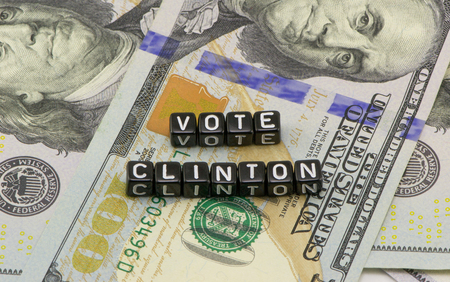 votes: Clinton Votes for dollars background Stock Photo