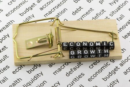 mousetrap: Economic growth in a mousetrap Stock Photo
