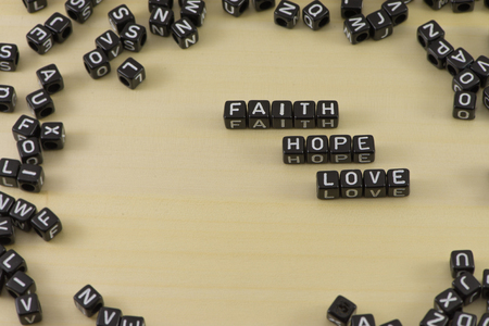 Block advertising with the words faith hope and love Stock Photo