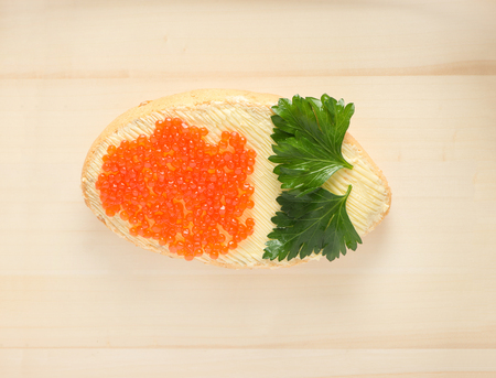 Festive meal with caviar on wood background