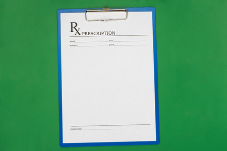 Blank prescription form on desktop background Stock Photo