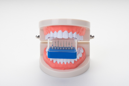Dental character of dental treatment on a white background