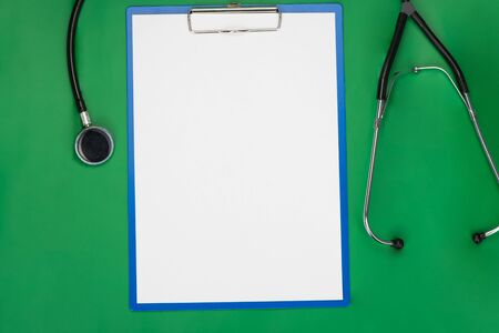 general insurance: Empty blank on the medical table green