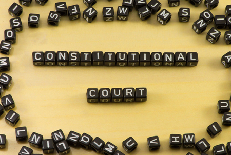 constitutional law: The word constitutional court on wood background Stock Photo