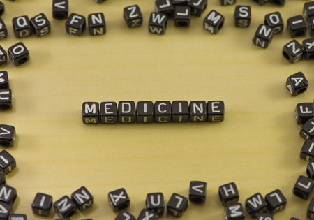 word medicine: Word medicine on a wooden background Stock Photo