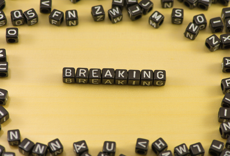 newsflash: The word breaking on wood background