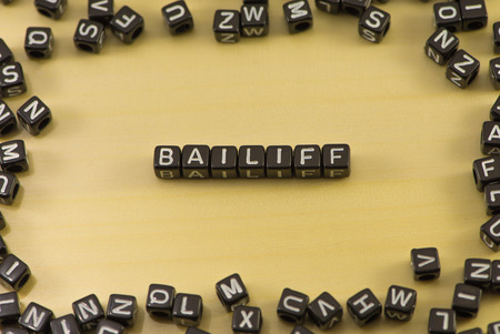 no integrity: The word bailiff on wood background Stock Photo