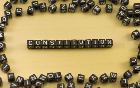 The word constitution on wood background Stock Photo