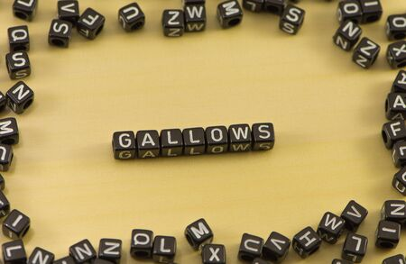 gallow: The word gallows on wood background