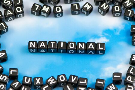 The word National on the sky background