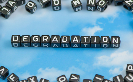 The word Degradation on the sky background
