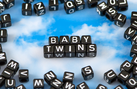 The word baby twins on the sky background Stock Photo