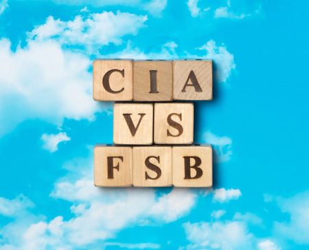 The word CIA vs FSB on the sky background