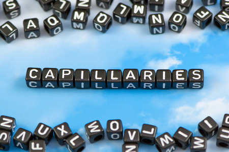 capillaries: The word Capillaries on the sky background